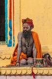 An Indian pilgrim is sitting in front of a temple Royalty Free Stock Image