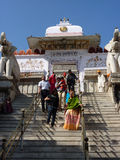 Indian pilgrims descend temple stairs Stock Photo