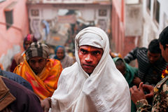 Indian pilgrims dressed in white rises to ancient Temple Stock Photography