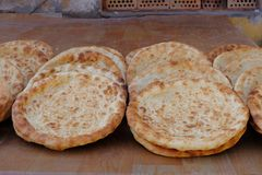 Indian pizza. Fresh baked plain Naan stock image