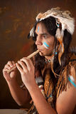 Indian playing the flute Royalty Free Stock Photo