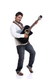 An Indian playing guitar Royalty Free Stock Photography