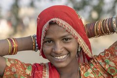 Indian poor girl on time Pushkar Camel Mela, Rajasthan, India, closeup portrait stock image