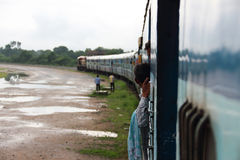 Indian poor. India is a particularly serious gap between the rich and poor countries.The Indian trains have no past the roof stand, carriage crowded phenomenon royalty free stock photo