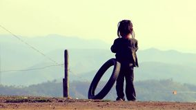 Indian poor village girl playing with tire