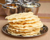 Indian Poppadoms. With pickle and chutney tray Stock Photo