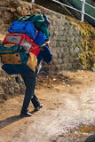 Indian Porter Carrying Heavy Bags Manual Labor Royalty Free Stock Photos