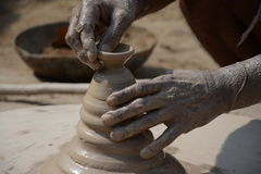 An Indian potter makes earthen lamps or 'diyas' ahead of the forthcoming Diwali festival Stock Photo