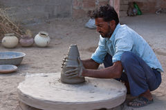 Indian Potter at Work Stock Photo