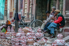 Indian pottery sellers. Group of men selling pots and other pottery made from clay Royalty Free Stock Photo
