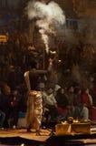 Indian priest performs religious Ganga Aarti ceremony or fire puja at Dashashwamedh Ghat in Varanasi. Uttar Pradesh Royalty Free Stock Images