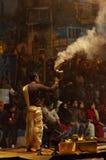 Indian priest performs religious Ganga Aarti ceremony or fire puja at Dashashwamedh Ghat in Varanasi. Uttar Pradesh Royalty Free Stock Photos