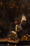 Indian priest performs religious Ganga Aarti ceremony or fire puja at Dashashwamedh Ghat in Varanasi. Uttar Pradesh Stock Photo