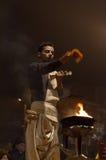Indian priest performs religious Ganga Aarti ceremony or fire puja at Dashashwamedh Ghat in Varanasi. Uttar Pradesh Stock Image