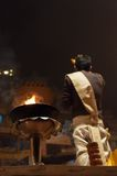 Indian priest performs religious Ganga Aarti ceremony or fire puja at Dashashwamedh Ghat in Varanasi. Uttar Pradesh Royalty Free Stock Image