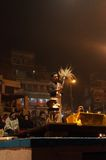 Indian priest performs religious Ganga Aarti ceremony or fire puja at Dashashwamedh Ghat in Varanasi. Uttar Pradesh Royalty Free Stock Photo