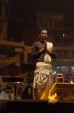 Indian priest performs religious Ganga Aarti ceremony or fire puja at Dashashwamedh Ghat in Varanasi. Uttar Pradesh Stock Photos