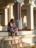 Indian priest sitting in a front of a temple royalty free stock photos