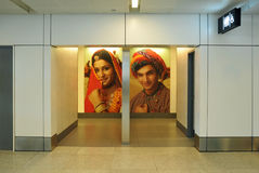 Indian public toilet. Delhi, India - june 2011 - entrance to the public toilet, both ladies and mens, with indian picture on the background, in the international Stock Photo