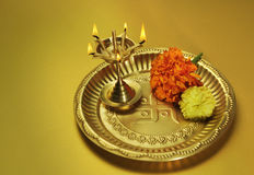 An Indian 'Puja' Plate. Traditional indian lamp and flowers in a plate Stock Images