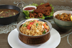Indian Pulav or Vegetable Pulao with Chana Masala and Dal Makhan Stock Images
