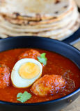 Indian Punjabi meal-Egg curry and roti. Indian meal -egg curry and Indian flat bread roti for main course,lunch or dinner Royalty Free Stock Image