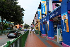 Indian quarter in Singapore. Busy street in Singapore`s Indian quarter. One of the famous tourist attractions in the city crowded with people in the midday Royalty Free Stock Image