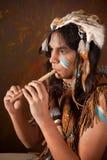 Indian que joga a flauta foto de stock royalty free