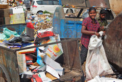 Indian Rag Pickers Search For Recyclable Material In The Garbage Collection Center On Stock Photography