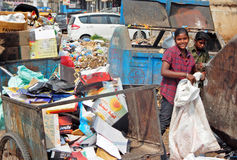Indian rag pickers search for recyclable material in the garbage Royalty Free Stock Photos