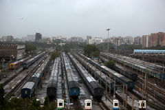 Indian Railway. A birds eye view of trains at a railway junction in Mumbai, India on a rainy evening Royalty Free Stock Photo