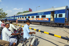 Indian Railway Train Passes A Railroad Crossing Stock Photos