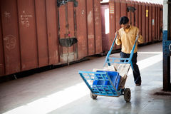 Indian railway worker pulling cart Stock Photography