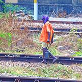 Indian railway worker walking along tracks Royalty Free Stock Photos