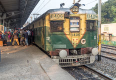 Indian railways morning local train boarding passengers at a station. stock images