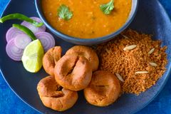 Indian Rajasthani meal-Dal baati churma closeup. Indian Rajasthani meal consisting of Daal,Baati and choorma.Grilled wheat dumplings served with lentils and Royalty Free Stock Photography
