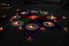 Indian Rangoli with full of colours and lights . royalty free stock image