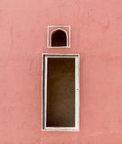 Indian red window. A traditional indian window on a red wall Royalty Free Stock Images