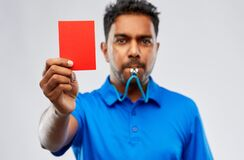Free Indian Referee Whistling And Showing Red Card Stock Photos - 184299873