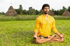 Indian relaxing by yoga stock images