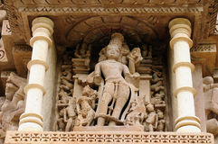 Indian religious erotic symbols on temples in Khajuraho. India, Sculptures religious erotic sybmboli of the Indian faith on walls of temples in Khujaraho temples Royalty Free Stock Photography