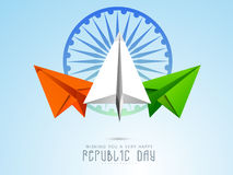 Indian Republic Day celebration with paper plane and Ashoka Whee. Indian Republic Day celebration concept with national flag color paper plane and Ashoka Wheel Stock Images