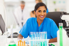 Indian researcher working. Beautiful young indian researcher working in lab Stock Photo