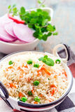Indian Rice Dish. Pilaf in a skillet vertical image Royalty Free Stock Images