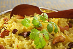 Indian Rice Pilau. Classic fruit and nut Indian pilau, basmati rice cooked with stock, saffron, garlic, onion, cinnamon, cardamom, sultanas and garnished with Stock Photos