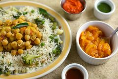 Indian Rice Pulao with Chickpeas, Broccoli and Sauces Royalty Free Stock Photo