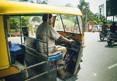 Indian ricksha driver Stock Image
