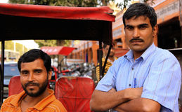 Indian Rickshaw Owners. JAIPUR, INDIA, MARCH 4: Two unidentified rickshaw owners outside the City Palace on March 4, 2012 ahead of the annual Holi Festival in Royalty Free Stock Photo