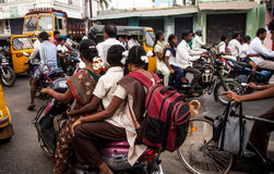 Indian riders ride motorbikes on busy road Royalty Free Stock Photos