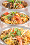 Indian risotto biryani in metal or bronze bowls Royalty Free Stock Photography